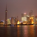 Shanghai's Pudong Skyline at night, including the pink Oriental Pearl Tower